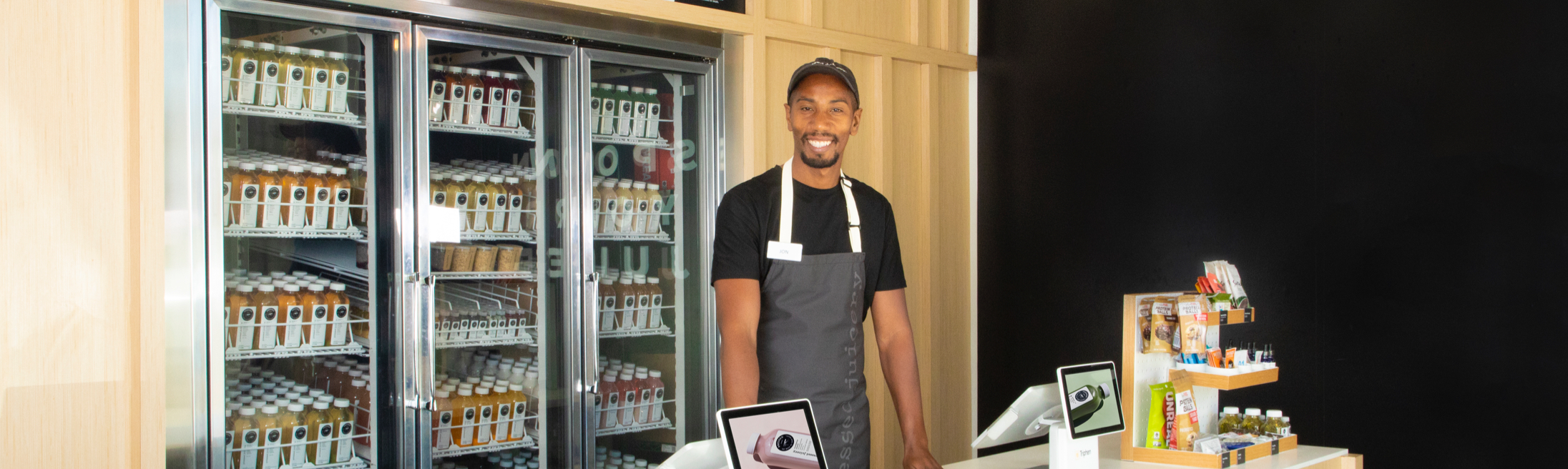 A Pressed Employee standing behind a counter.