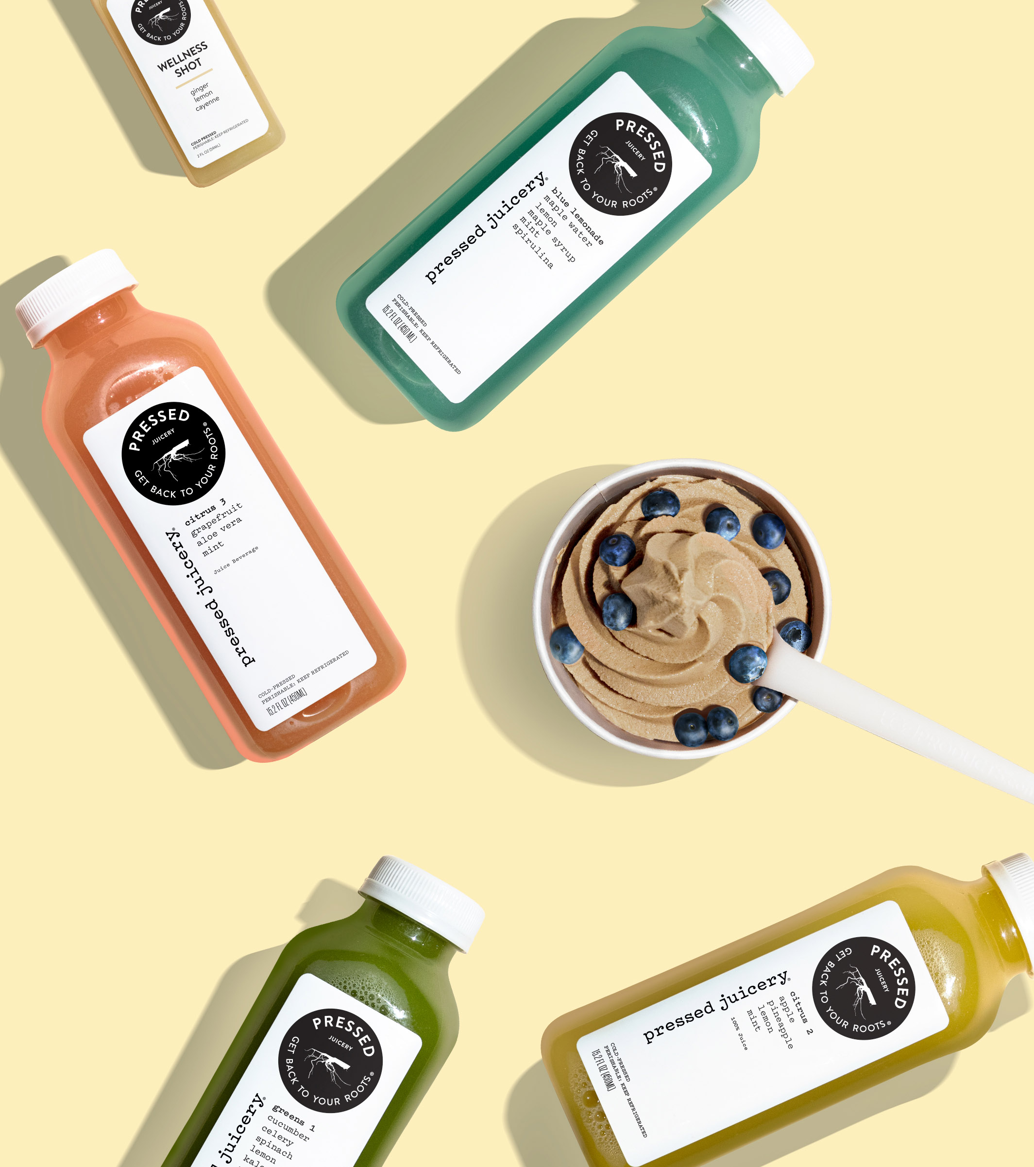 Bottles of Pressed Juicery juice and a cup of Freeze.